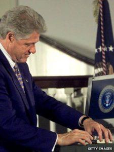 Bill Clinton signing ann executive order.